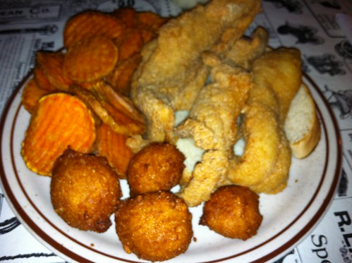 Catfish, hushpuppies, and sweet potato fries