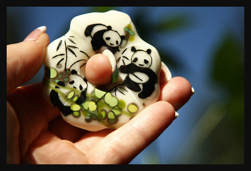A new fused glass panda pendant ready for final firingt