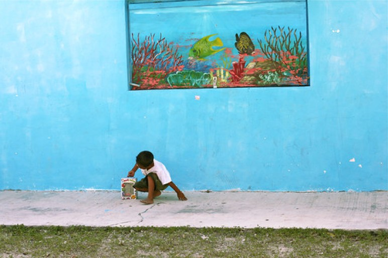 School Boy Infront of Aquarium Mural, Akumal, Mexico