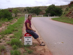 Sitting on one of the mile markers that dot Madagascars main roads.