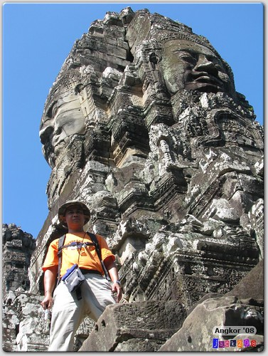 shrapnel in front of a face tower at Bayon