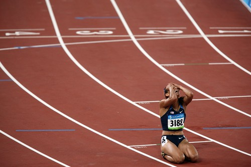 Jones was leading the race when she tripped over the second-to-last hurdle, ending her hopes for a medal