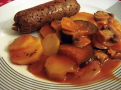 Spicy italian sausages with lemony tomato roasted potatoes