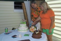 Cutting their cakes. Notice the brides comfy outfit change!