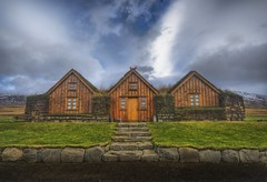 3 grass-roofed houses