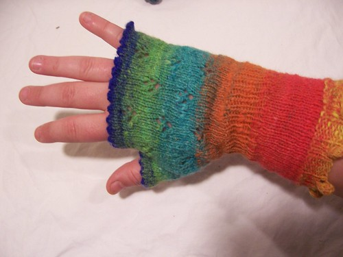 These Whimsical mitts are knitted in the round from the bobble cuffs to the picot finger edging.