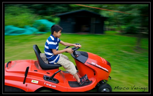 King driving Opas lawnmower