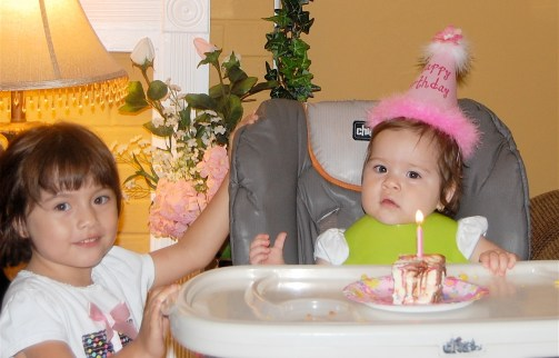 big sis helped her blow out the candle