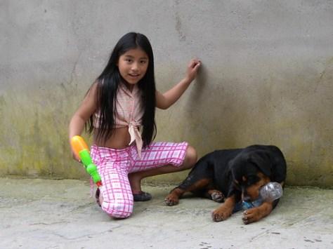 A girl, gun, and dog