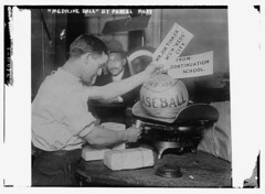 Medicine ball being weighed by Post Office emp...