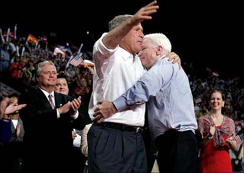 Senator John McCain and President George W. Bush embracing in a very intimate hug...not that there is anything wrong with that.