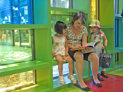 A woman reading to children.