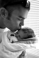 New Daddy Kissing Baby