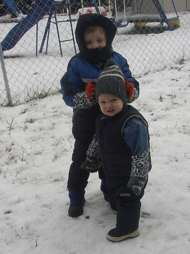 ian & spencer playing in snow