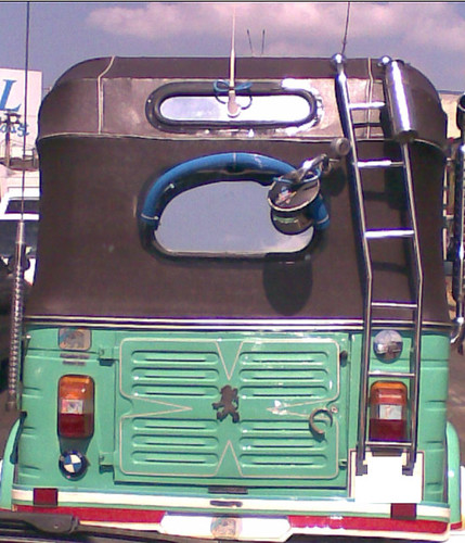 Trishaw (Three wheel taxi) with BMW and Peugeot car emblems - Colombo, Sri Lanka