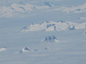 BC mountains through clouds