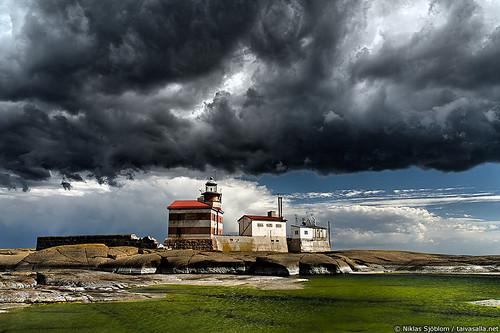 Dark Clouds Above Märket Lighthouse by taivasalla