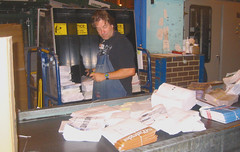 20030926 - USPS - worker cutting open flat mai...