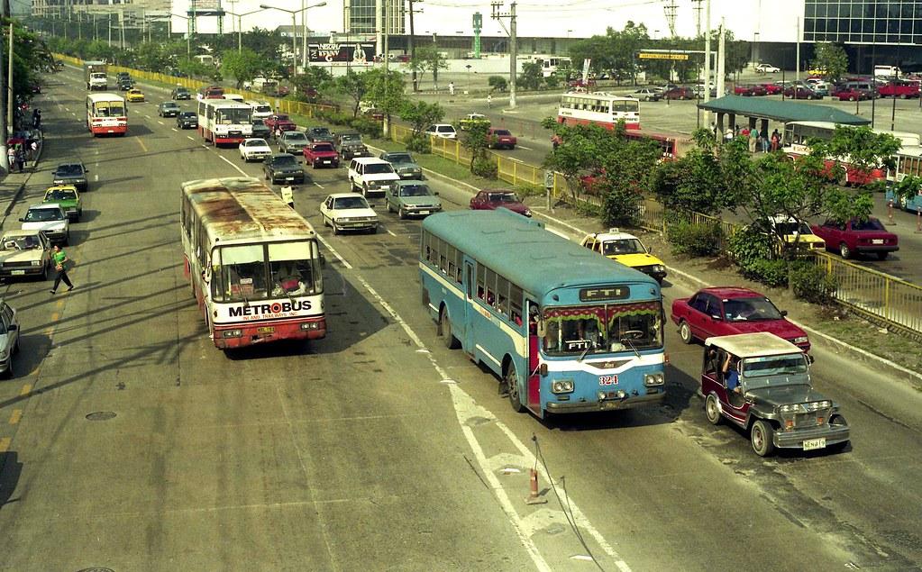 Metrobus NXL-153 & Metro Manila Transport Hino NVJ-359 (324) EDSA, Mandaluyong, Manila, Philippines.