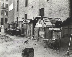 Unemployed and huts, West Houston -- Mercer St...