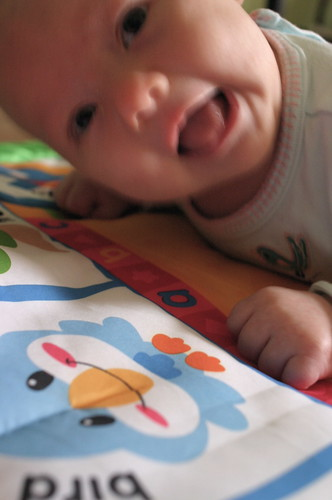 blurry, happy, tummy time baby.
