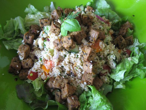 Salad with couscous, orang-basil tempeh and sweet miso dressing