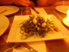 Squid with cherry tomatoes and rocket salad