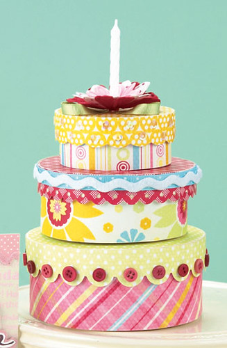Talk about versatility! Can you imagine all the possibilities this Birthday Cake Gift Box Tower by Cindy Gilchrist (p. 49) offers? You could use it as a baby gift wrap, putting a cute pair of booties at the top or as an Easter brunch hostess gift, putting a little nest of jelly beans at the top.  Or how 'bout changing the color scheme and using it as a Father's Day gift wrap?