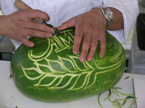A participant carves a watermelon in the Food Culture USA program at the 2005 Smithsonian Folklife Festival.
