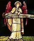 William Morris. Diseño pintado en vidrio. One of Six Angels Holding a Scroll, Trinity Church, Saugerties, NY.