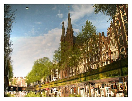 Church and canal houses by you.