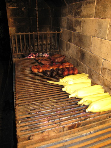 The wood from the first stage has been consumed. The embers are ready to be used in stage two. Embers are spread under the lowered grill in stage three.