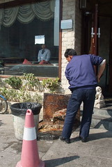 man cleaning restaurant grease trap