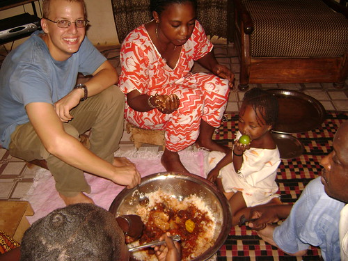 Lunch -- rice and fish balls -- with Chris Senegalese family.