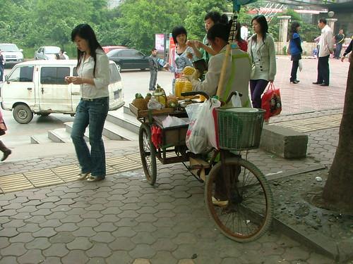 Women selling fresh pineapple