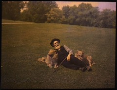 Man lying on ground with two dogs
