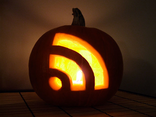 Photo of a jack-o-lantern carved into an RSS symbol