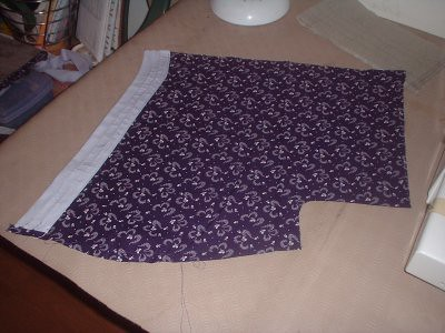 top left part of the top, with the collar attached