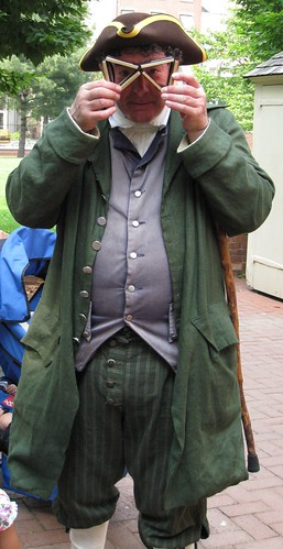 Animator in period costume near Carpenter Hall