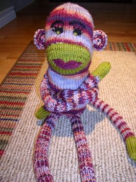 LOL!  Im not sure why Funky Sock Monkey shows up in a search for camp, but its too cute not to include.