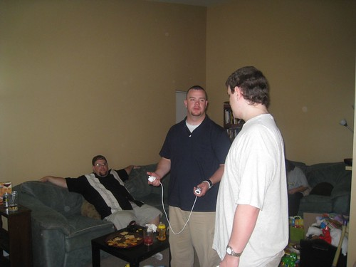 Greg and his brothers playing the Wii