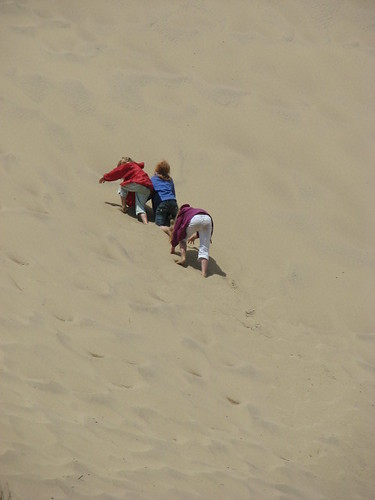 Emily, Laura and Elizabeth climbing the dune