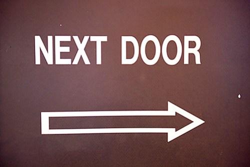 Next Door Arrow Sign