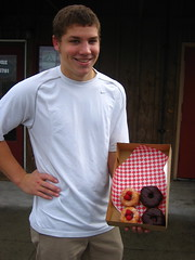 Luke and donuts.  The ones on the left have fresh raspberries on top.