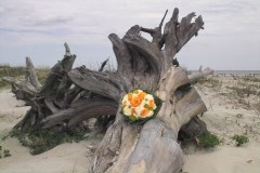 The brides beautiful orange bouquet.
