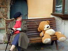 Grumpy German lady and oversize teddy bear.