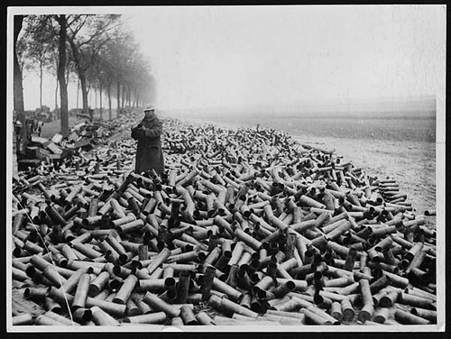 Some shell cases on the roadside in the front area, the contents of which have been despatched over into the German lines by National Library of Scotland