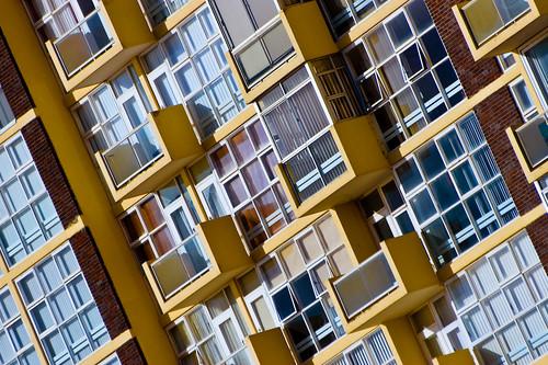 Slanted apartment block windows