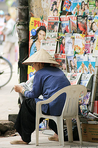 a woman read a newspapers about women by My Lucky Stars.