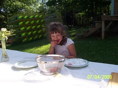 Olivia enjoying fruit fresh from the garden
